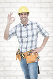 Composite image of handyman gesturing ok sign Royalty Free Stock Photo