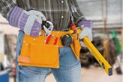 Composite image of handyman holding spirit level Royalty Free Stock Images