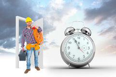 Composite image of handyman holding tool box and multimeter Royalty Free Stock Image