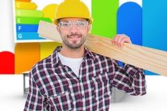 Composite image of handyman holding wood planks. Handyman holding wood planks against house with energy rating background Royalty Free Stock Image