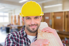 Composite image of handyman holding wood planks Royalty Free Stock Images