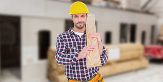 Composite image of handyman holding wood planks Royalty Free Stock Image