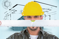 Composite image of handyman looking at spirit level Royalty Free Stock Photos