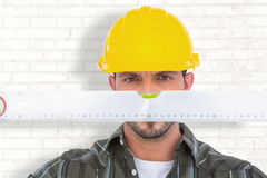 Composite image of handyman looking at spirit level Stock Photos