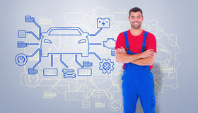 Composite image of handyman in overalls standing arms crossed over white backgound Stock Images