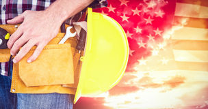 Composite image of handyman with tool belt and handyman Stock Images