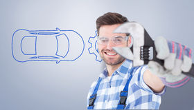 Composite image of handyman wearing protective glasses while holding wrench Stock Photos
