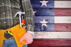 Composite image of handyman wearing tool belt Royalty Free Stock Photos