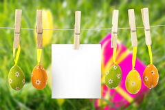 Composite image of hanging easter eggs Stock Photos