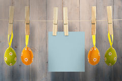 Composite image of hanging easter eggs and card Stock Image
