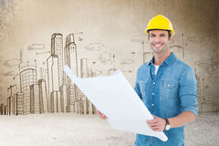 Composite image of happy architect holding blueprint in house Stock Photo