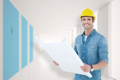Composite image of happy architect holding blueprint in house. Happy architect holding blueprint in house against modern blue and white room Stock Images