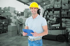 Composite image of happy architect holding clip board Royalty Free Stock Image