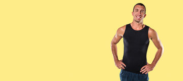 Composite image of happy athlete with hands on hip standing Stock Image