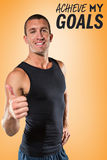 Composite image of happy athlete showing thumbs up Stock Photos