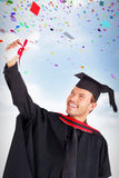 Composite image of happy attractive boy celebrating his graduation Royalty Free Stock Photography