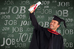 Composite image of happy attractive boy celebrating his graduation Royalty Free Stock Image