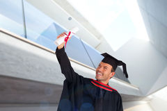 Composite image of happy attractive boy celebrating his graduation Stock Image