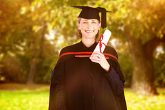 Composite image of happy attractive graduate Stock Photography