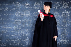 Composite image of happy blonde girl celebrating success with diploma Stock Photography