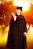 Composite image of happy blonde girl celebrating success with diploma Stock Photo