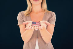 Composite image of happy blonde holding our her hands Royalty Free Stock Image