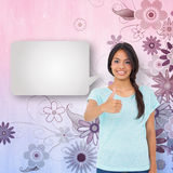 Composite image of happy brunette giving thumbs up with speech bubble Stock Photos
