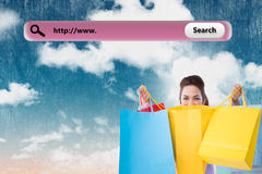 Composite image of happy brunette opening shopping bags Stock Image