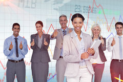 Composite image of happy business people looking at camera with thumbs up Royalty Free Stock Photo