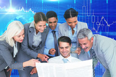 Composite image of happy business people looking at newspaper Royalty Free Stock Photos