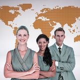 Composite image of happy business team smiling at camera Royalty Free Stock Photo