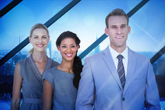 Composite image of happy business team smiling at camera Stock Images