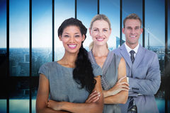 Composite image of happy business team smiling at camera Stock Photography