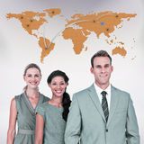 Composite image of happy business team smiling at camera Royalty Free Stock Image