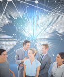 Composite image of happy business team smiling at each other Royalty Free Stock Photography