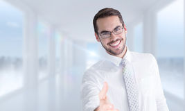 Composite image of happy businessman with glasses offering handshake Royalty Free Stock Photography
