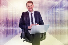 Composite image of happy businessman with laptop using smartphone Stock Photography