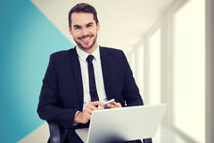 Composite image of happy businessman with laptop using smartphone Royalty Free Stock Photos