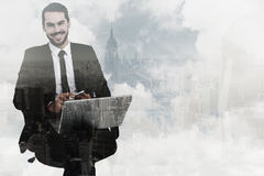Composite image of happy businessman with laptop using smartphone Stock Image