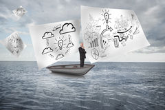 Composite image of happy businessman looking away in a sailboat Royalty Free Stock Photos