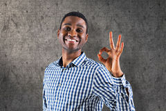 Composite image of happy businessman making ok sign Stock Photos
