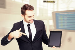 Composite image of happy businessman pointing with his tablet Stock Images