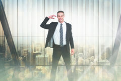 Composite image of happy businessman posing and gesturing Royalty Free Stock Photos