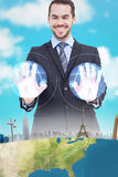 Composite image of happy businessman presenting his hands Stock Photos