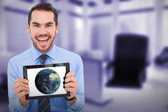 Composite image of happy businessman showing his tablet pc Stock Image
