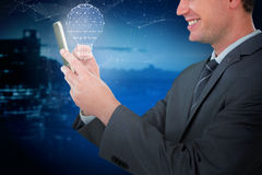 Composite image of happy businessman using mobile phone Stock Photo