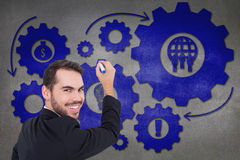 Composite image of happy businessman writing with marker Royalty Free Stock Image