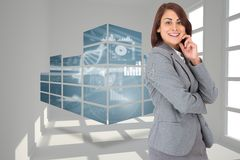 Composite image of happy businesswoman Stock Photo