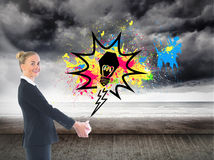 Composite image of happy businesswoman looking at camera Royalty Free Stock Images