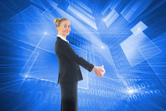 Composite image of happy businesswoman looking at camera Stock Images
